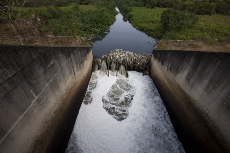 Sept. 11, 2012. Toxic foam forms as trash accumulates against a floodgate along the Sarapui river in Nilopolis, Rio de Janeiro, Brazil.