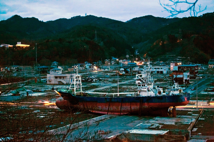 March 6, 2012. A fishing boat, dragged in-land during last year's tsunami, sits on the ground in Kesennuma, Japan.